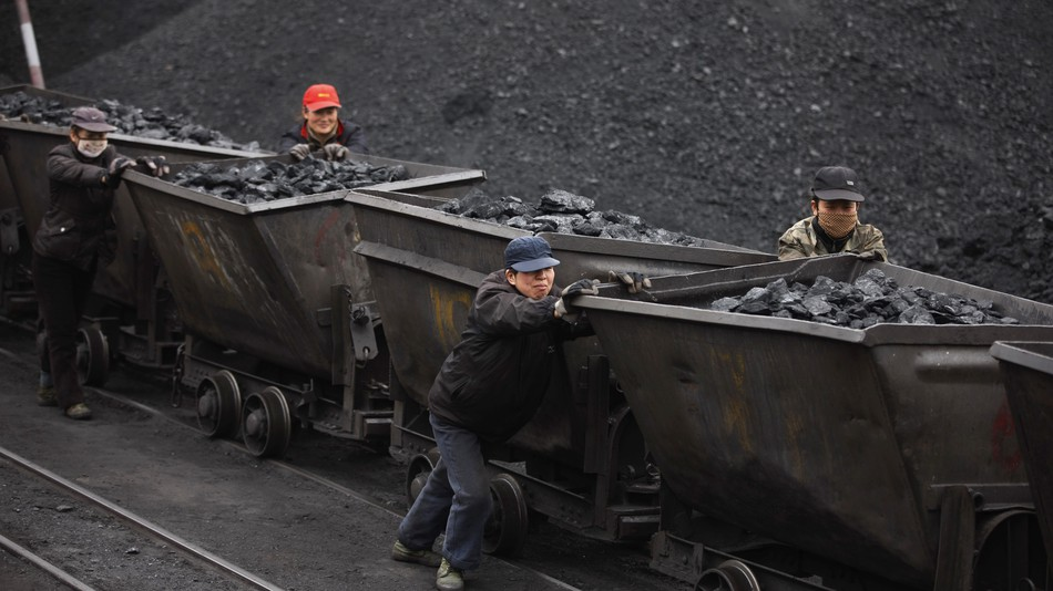 Chinese workers hauling minerals.