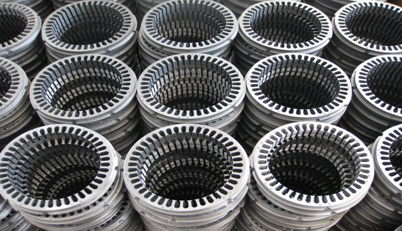 Piles of non-oriented electrical steel plates await to be turned into ev motors.