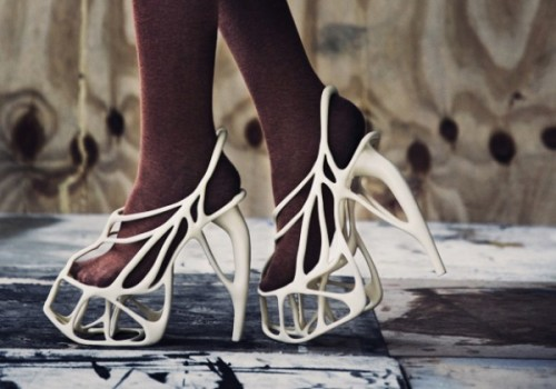 A pair of Josefi's Melonia heels wrap perfectly around a model's feet.