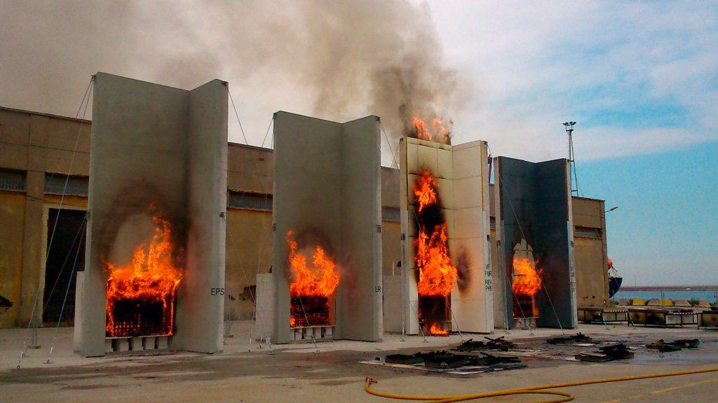 Four different materials undergoing a fire resistance test.