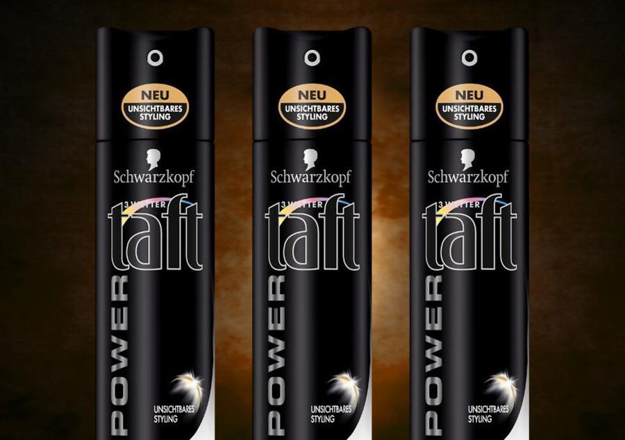 Three Taft aerosol cans.