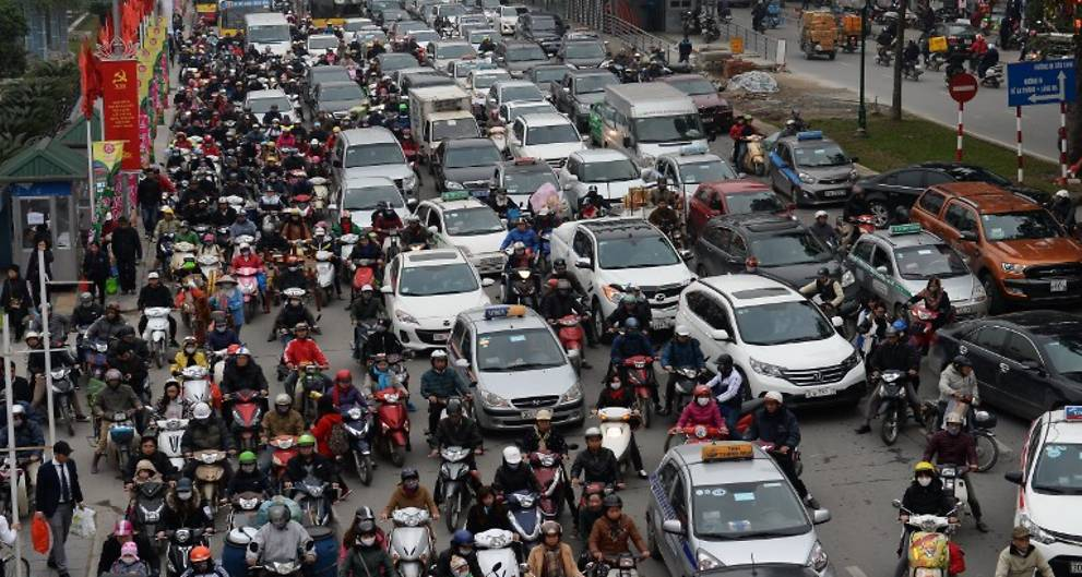 Hanoi bustling with cars and motorcycles.
