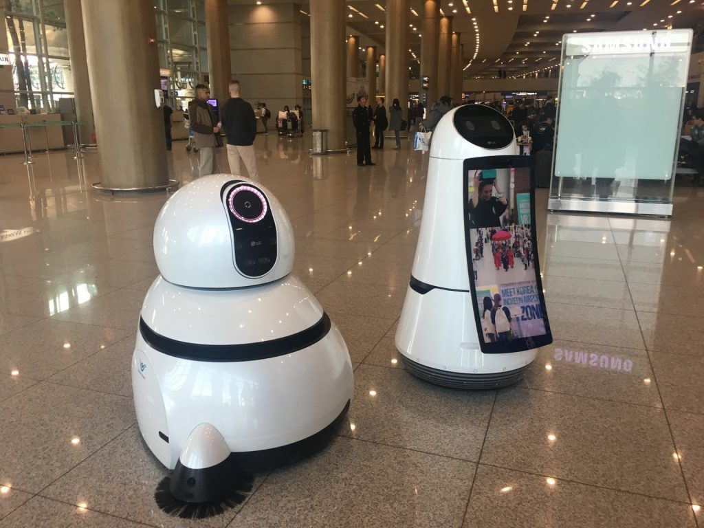 LG's Airport Guide Robot and Airport Cleaning Robot.