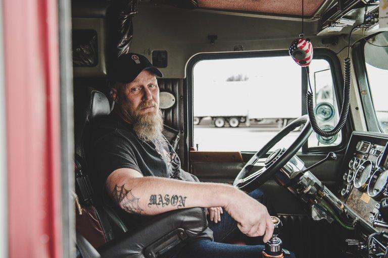 An American truck driver inside his truck.